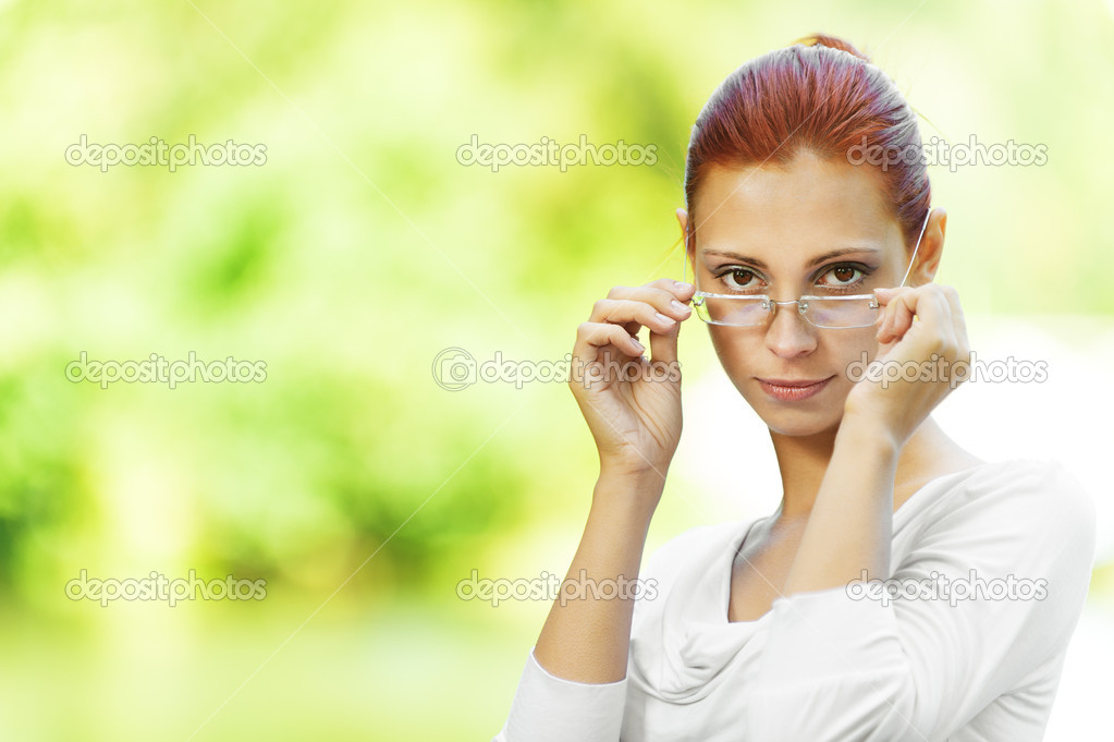 Beautiful woman looking over glasses