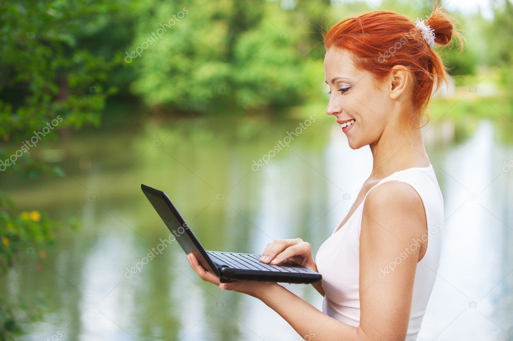 Beautiful woman typing on laptop keyboard