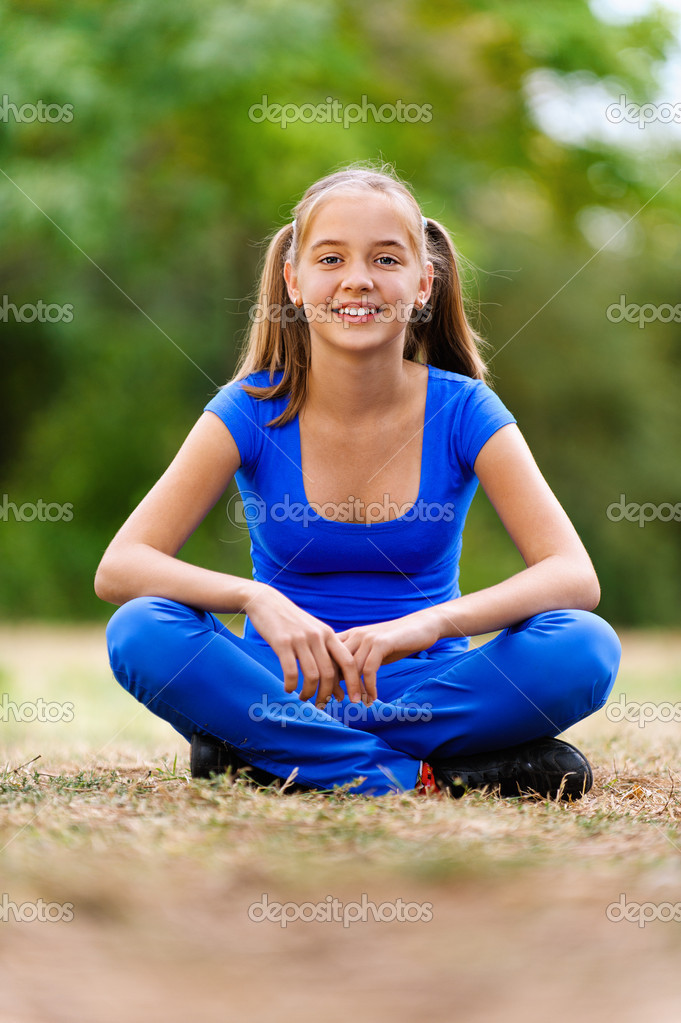 Teenage girl sitting in lotus position