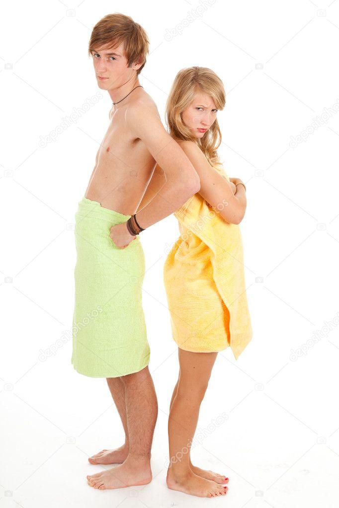 Teenage couple in towels