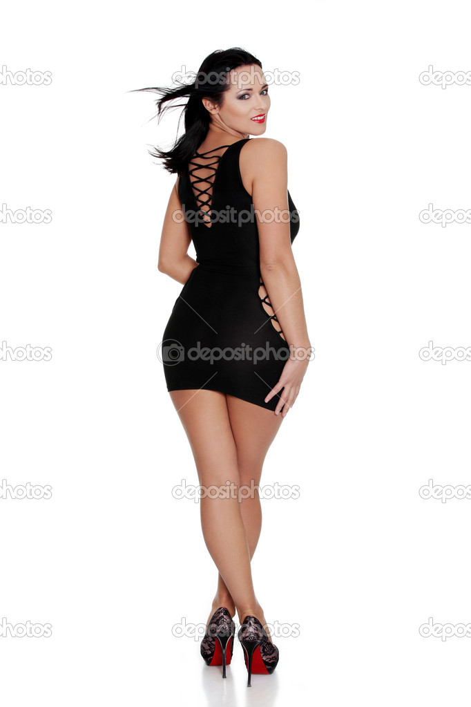 Beautiful woman in sexy black dress, isolated on white background — Photo  by piotr_marcinski