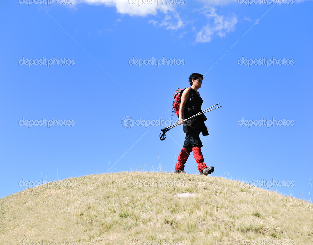 Sport walking on the ball hill woman trekking