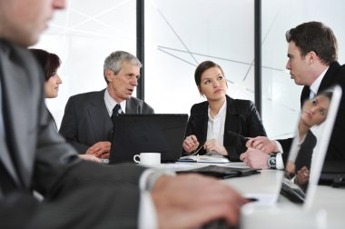 Group of business at meeting in office