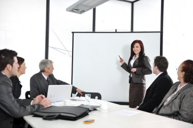 Business meeting - group of in office at presentation
