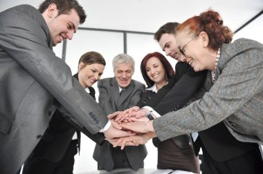 Group of business with hands together for unity and partnership