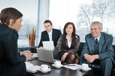 Businesswoman in an interview with three business getting positive feedback