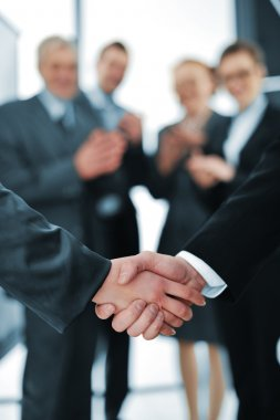Succesful handshake with business aplauding
