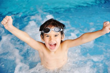 Summertime and swimming activities for happy children on the pool