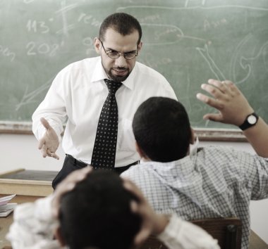 Education activities in classroom, teacher yelling at pupil