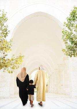 Muslim Arabic family indoor, White mosque