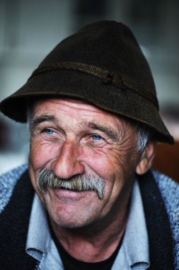 Portrait of old man with mustache