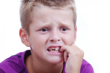 Stress expression on little blond kid's face