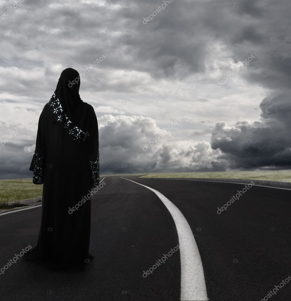 Muslim woman walking alone searching for the right path, conceptual image