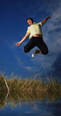 Young active man jumping, darkness