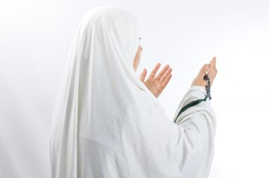 Veiled woman praying