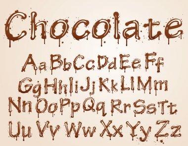 Dark chocolate alphabet on a white background.