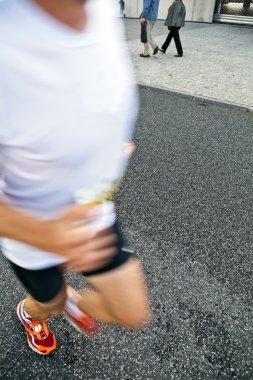 Man running in city marathon