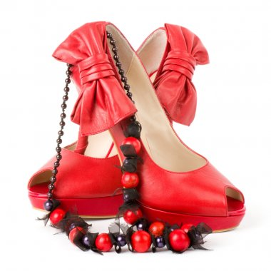 Sexy fashionable shoes with beads on white background.