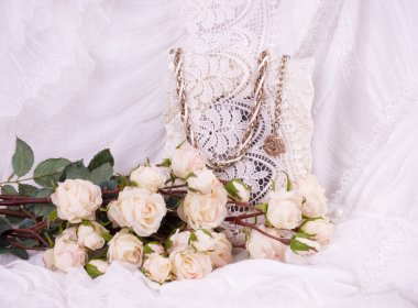 Beautiful roses and vintage frame on background