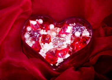 Beautiful bright colorful stones and pearl in heart for valentine day