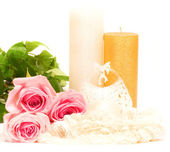 Fotografie Romantic still-life with white candle and roses