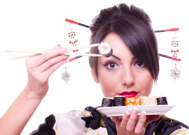 Young beautiful woman with Japanese sushi rolls,
