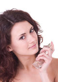 Portrait of beautiful young woman with perfume bottle