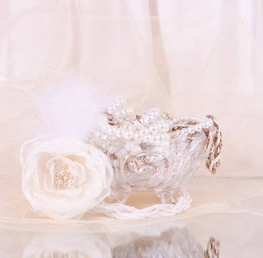 The beautiful bridal rose with wedding beads in crystal vase
