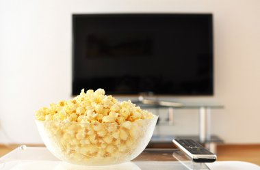 Pop-corn and remote control against TV-set