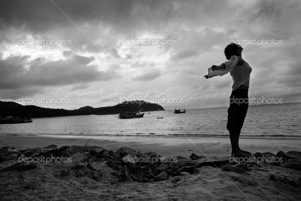 Woman enjoying the wind and the sea