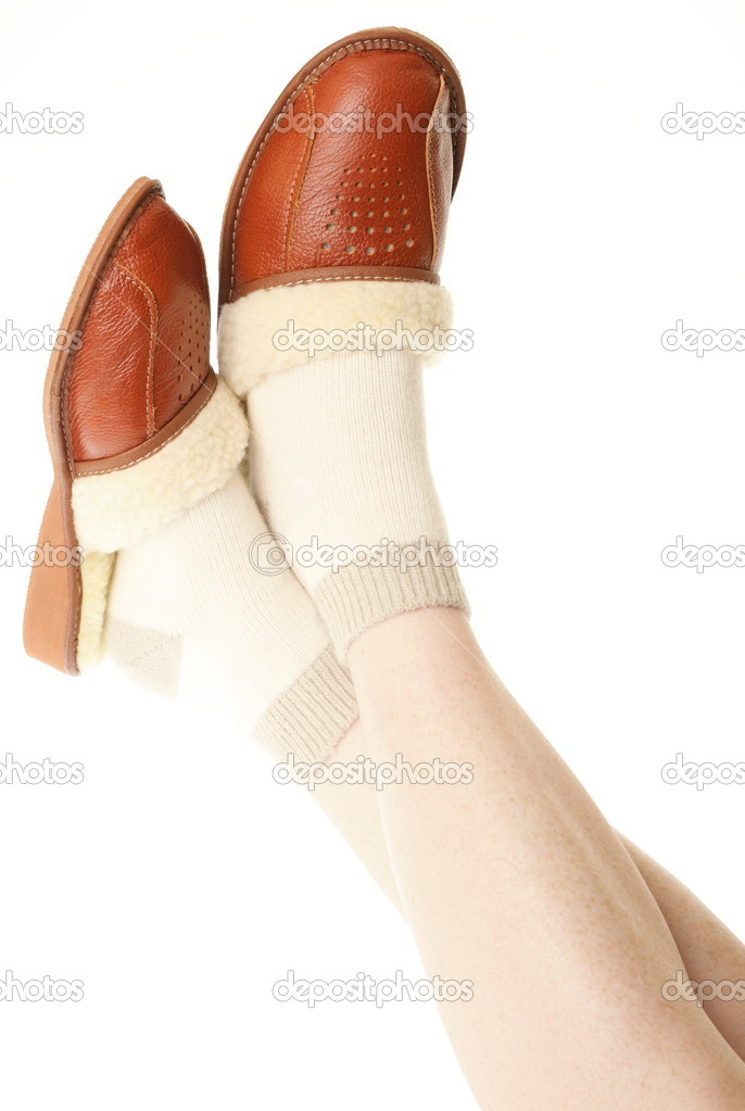 7822df9820b Brown wool comfortable slippers and thick woollen socks on the foot - house slipper  isolated on white background — Photo by ...