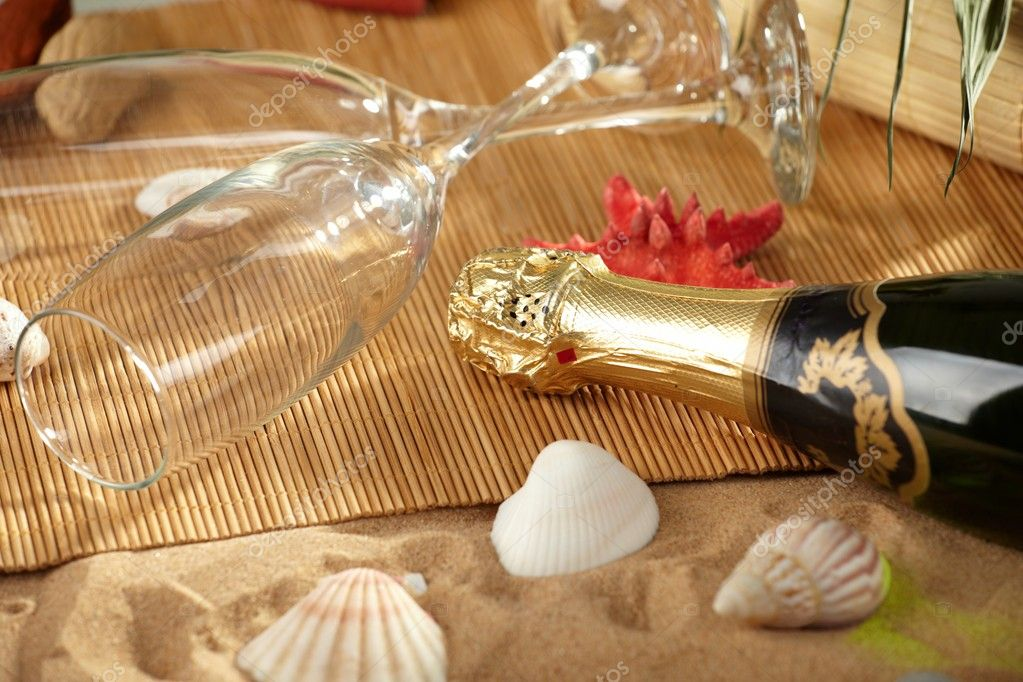 Champagne sparkling on a beach