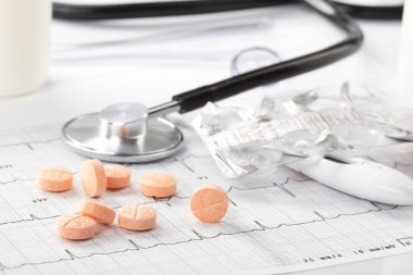 Pills on the cardiogram stock vector
