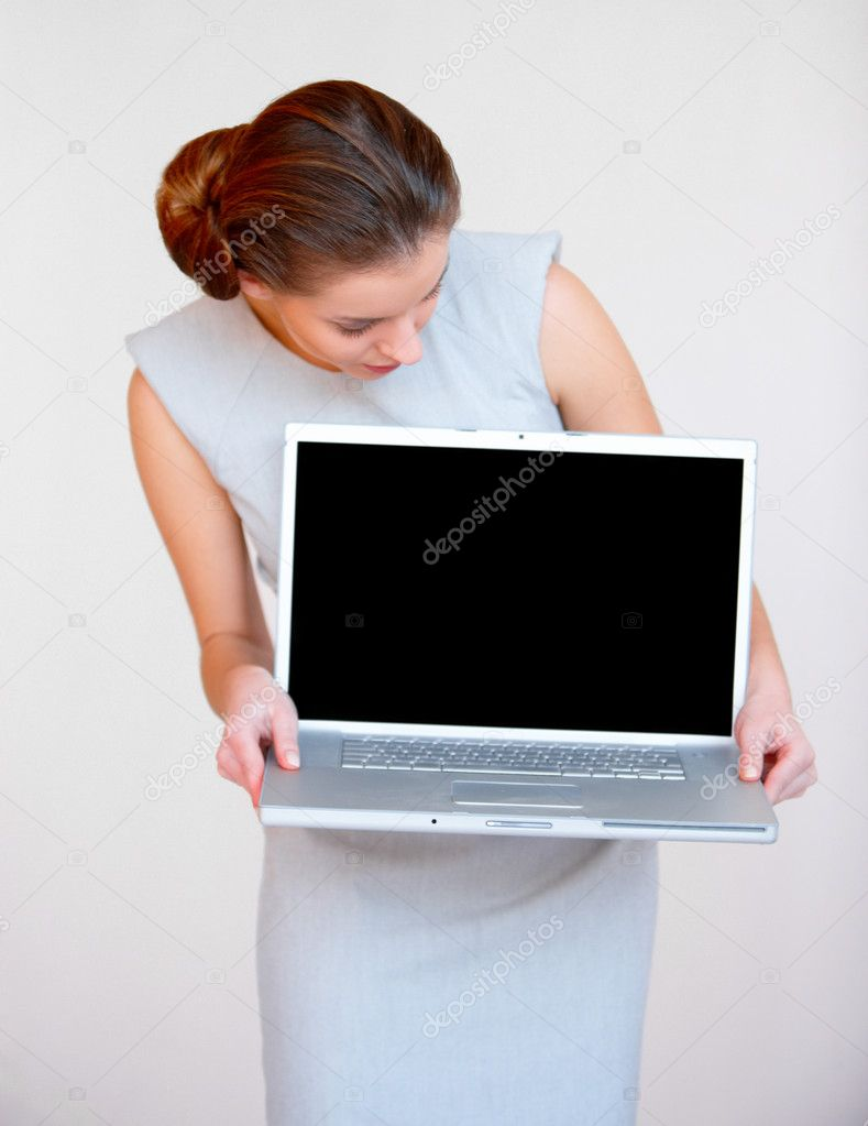 Young attractive business woman with laptop computer
