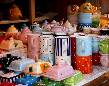 Colourful ceramic tableware in a market stall