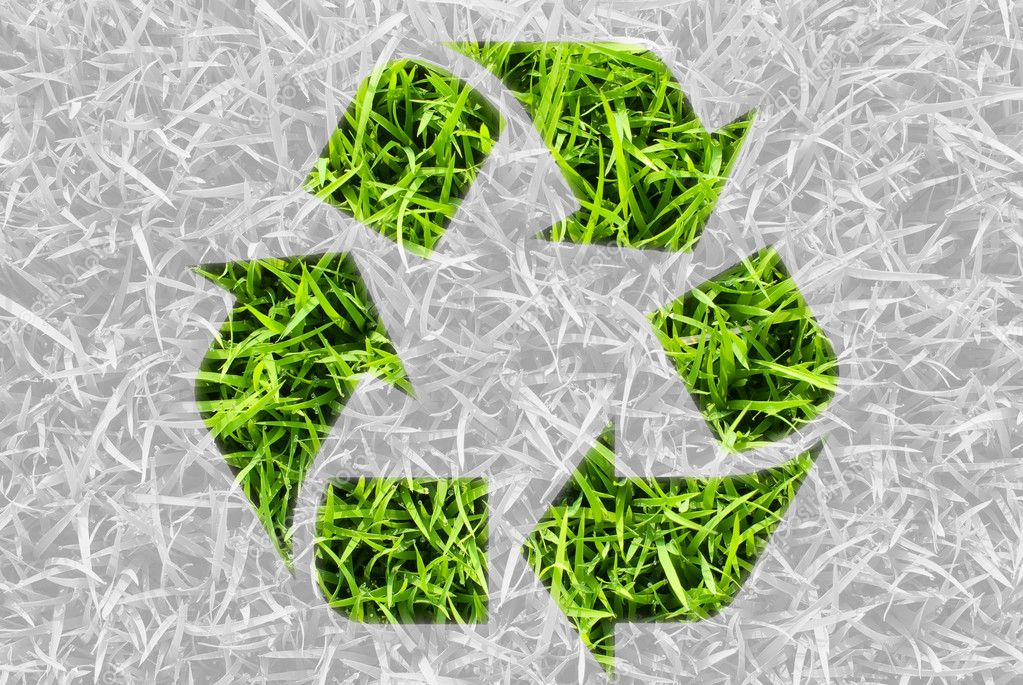 Recycle for green nature, symbol by fresh grass leaves.