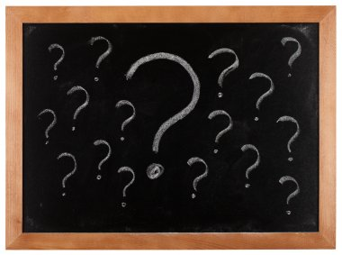 Question marks on blackboard