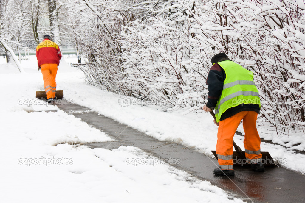 Workers removing first snow