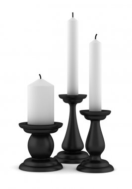 Three black candlesticks with candles isolated on white background