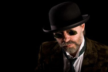 Man in vintage sunglasses pince nez
