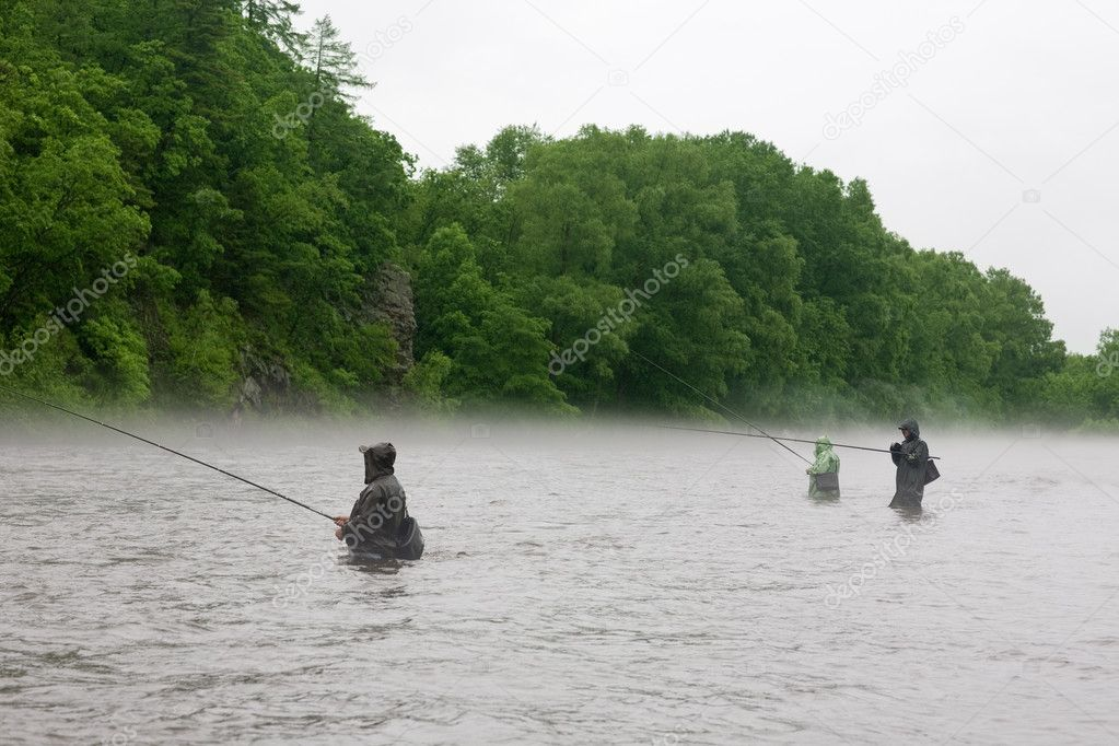 Fishermen catch salmon river