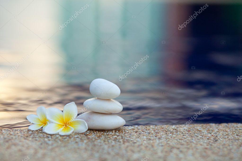 Plumeria flower and stones