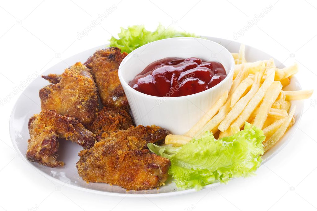 Chicken wings with sauce and fries on white background