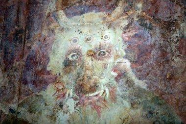 Detail of evil -eating monster in hell