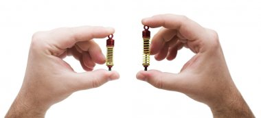 Shock absorbers from the toy car in hands