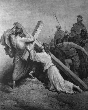 Jesus carries the heavy cross.