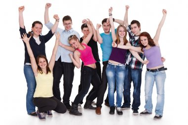 Happy group of with arms up - isolated over white