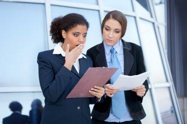 Businesswomen checking document