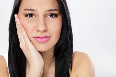 Young woman with toothache
