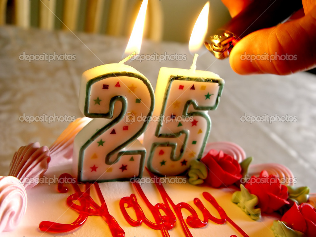 Lighting Birthday Candles For Someone Who Is 25 Years Old Photo By